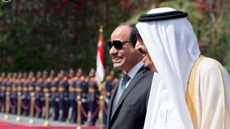 Egypt's President Abdel Fattah al-Sisi and Saudi Arabia's King Salman review the honour guards in Cairo